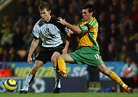 Fotball<br /> England 2004/2005<br /> Foto: SBI/Digitalsport<br /> NORWAY ONLY<br /> <br /> Barclays Premiership.<br /> Norwich City v Fulham<br /> 4/12/2004.<br /> <br /> Norwich's Marc Edworthy and Fulham's Brian McBride