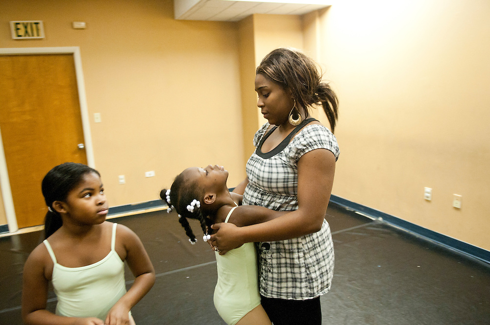 """Photo by Matt Roth.Saturday November 27, 2010..Candice Kemp, 23, is a young entrepreneur and newlywed who owns Inertia Performing Arts, a small dance studio located in downtown Baltimore. While """"Miss Candice"""" as she's known by her students, is able to pay the bills, sometimes parents won't pay theirs. Her business is not in danger of closing, but Candice is still scraping by financially. To make extra money she works at Tomorrow's Child Infant and Child Development Center, her mother's business."""