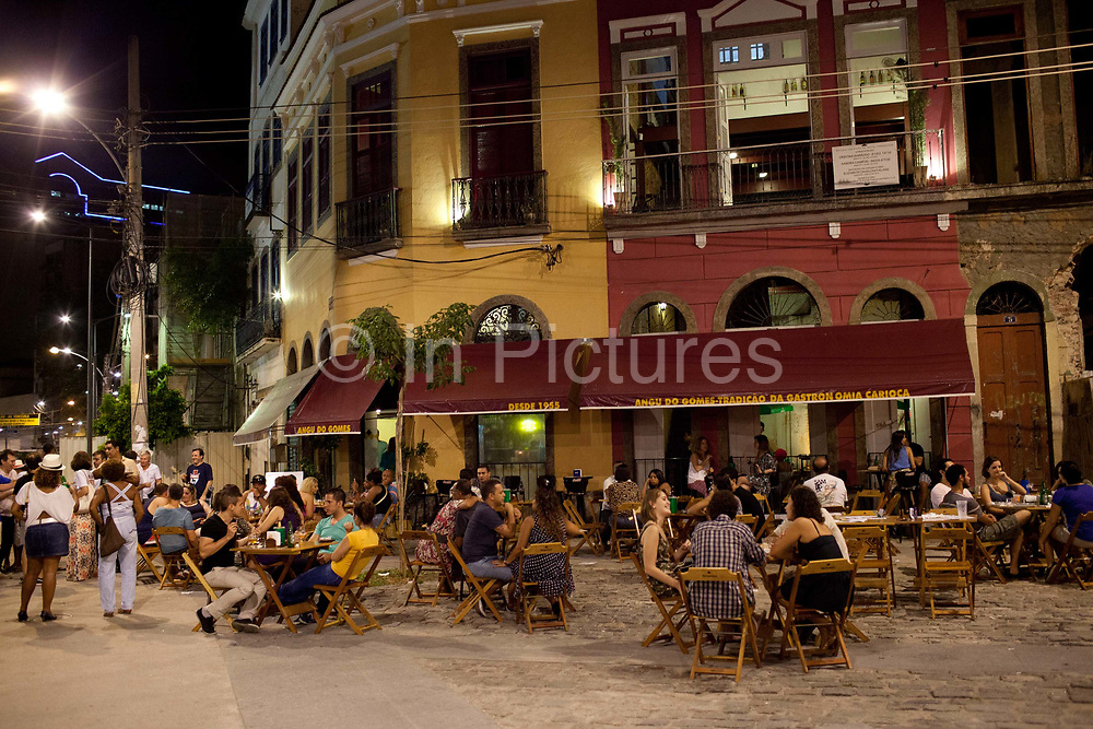 Bar boteca restaurant with people sitting outside it, near Pedra do Sal, the birthplace of Samba, in Gamboa district which was the neighbourhood where the ex slaves lived after abolition, sometimes referred to as the first favela. Rio de Janeiro, Brazil