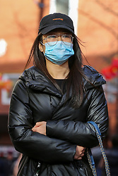 © Licensed to London News Pictures. 01/03/2020. London, UK. An Asian woman wearing a surgical face mask in Chinatown as a precaution against new type coronavirus (COVID-19). Twelve more people have tested positive for coronavirus in the UK, bringing the total number of cases to 35. Photo credit: Dinendra Haria/LNP