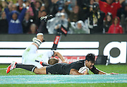 Julian Savea of the All Blacks dives over to score his second try as Chris Robshaw of England arrives to late during the third rugby test between the All Blacks and England played at Waikato Stadium in Hamilton during the Steinlager Series - All Blacks v England, Hamiton, 21 June 2014<br /> www.photosport.co.nz