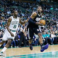 30 January 2013: Sacramento Kings power forward Jason Thompson (34) drives past Boston Celtics power forward Jeff Green (8) during the Boston Celtics 99-81 victory over the Sacramento Kings at the TD Garden, Boston, Massachusetts, USA.