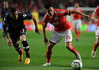 20120331: LISBON, PORTUGAL – Portuguese Liga Zon Sagres 2011/2012 - SL Benfica vs CS Braga.<br />In picture: Benfica's midfielder Nicolas Gaitan, right, fights for the ball with Braga's Miguel Lopes.<br />PHOTO: Alvaro Isidoro/CITYFILES