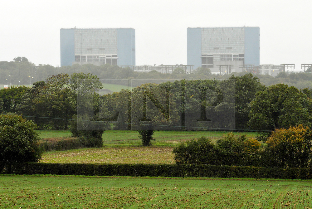 © Licensed to London News Pictures. 21/10/2013.  Hinkley Point, Somerset, UK.  Hinkley A, Hinkley Point Nuclear Power Station, which currently comprises the decommissioned Hinkley A station with Magnox Reactors (blue square buildings) and Hinkley B station (grey building complex, a more modern AGR design). The UK Government today announced the go-ahead for a new nuclear power station at Hinkley Point C in Somerset, to be built by a consortium with French firm EDF Energy and Chinese investment for the first time in UK nuclear power generation.21October 2013.<br /> Photo credit : Simon Chapman/LNP