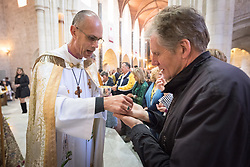 20 April 2019, Jerusalem: Bishop Cheetham distributes bread during Holy Communion, as Easter Sunday service is celebrated at the Cathedral Church of Saint George the Martyr, Jerusalem.