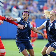 Russia defender Ksenia Tsybutovich (19), U.S. forward Sydney Leroux (2) and U.S. defender Kristie Mewis (19) fight for the ball during an international friendly soccer match between the United States Women's National soccer team and the Russia National soccer team at FAU Stadium on Saturday, February 8, in Boca Raton, Florida. The U.S. won the match by a score of 7-0. (AP Photo/Alex Menendez)