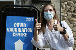 © Licensed to London News Pictures. 02/08/2021. London, UK. British/French/American actress Chloe Delanney gestures outside a vaccination centre in Tottenham, north London after receiving her Covid-19 vaccine. Booster jabs could be offered to 32 million from September, alongside flu jabs. Uber, Bolt, Deliveroo and Pizza Pilgrims will offer incentives to encourage young people to get their Covid-19 vaccine, as almost 3 million under-30s are yet to receive a first vaccine dose. Photo credit: Dinendra Haria/LNP