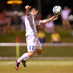 BRISBANE, AUSTRALIA - FEBRUARY 10: Nicholas Panetta of United heads the ball during the NPL Queensland Senior Mens Round 2 match between Gold Coast United and Brisbane Roar Youth at Station Reserve on February 10, 2018 in Brisbane, Australia. (Photo by Football Click / Patrick Kearney)
