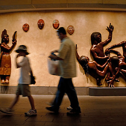 """WASHINGTON, DC -- Inside, the National Museum of the American Indian, one of the newest museums on the National Mall, tourists stroll past Roxanne Swentzell's """"For Life in All Directions, 2004"""" installation...Photo by Susana Raab.."""