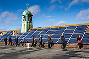 Solar PV Photo Voltaic panels on the roof of the Priory school in Lewes, East Sussex. Set up by  OVESCo community  investors. (pictured). This panel, or module, is made up of photovoltaic (PV) cells. PV cells convert sunlight into electrical energy.