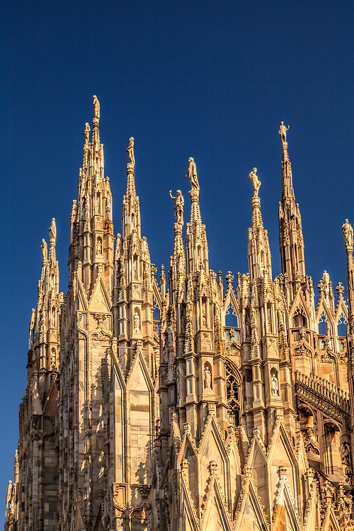 Milan Cathedral in Milan, Italy. The Duomo is decorated with an amazing number of beautifully sculpted statues and spires. There are more statues on this building than any other in the world, 3159 in total.