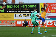 Mansfield Town defender Mal Benning (3) heads the ball during the EFL Sky Bet League 2 match between Mansfield Town and Carlisle United at the One Call Stadium, Mansfield, England on 1 February 2020.
