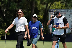 August 10, 2018 - St. Louis, Missouri, United States - (L-R) Tommy Fleetwood, Matthew Kelly and Ian Finnis walk off the 9th green during the second round of the 100th PGA Championship at Bellerive Country Club. (Credit Image: © Debby Wong via ZUMA Wire)