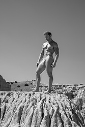 nude man on a rock formation
