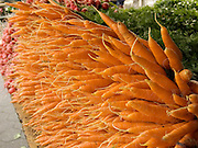 organic carrots displayed at a green market