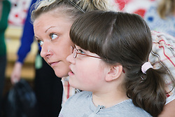 Child with cerebral palsy and teacher,