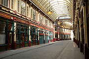 Leadenhall Market still remains totally deserted in the City of London on the day that it was announced that the Coronavirus lockdown measures are set to ease even further and the quiet city starts coming to an end, on 23rd June 2020 in London, England, United Kingdom. As of today the government has relaxed its lockdown rules, and is allowing some non-essential shops to open with individual shops setting up social distancing queueing systems.