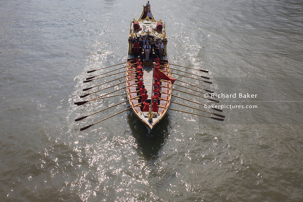 The royal rowbarge Gloriana is rowed on the River Thames on the occasion of celebrating the Queen's record of years as monarch.
