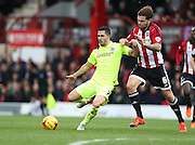 Brighton central midfielder, Beram Kayal (7) and Brentford defender Harlee Dean during the Sky Bet Championship match between Brentford and Brighton and Hove Albion at Griffin Park, London, England on 26 December 2015.