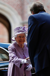Queen Elizabeth II arrive to attend Evensong in celebration of the centenary of the Order of the Companions of Honour at the Chapel Royal Hampton Court Palace in southwest London.