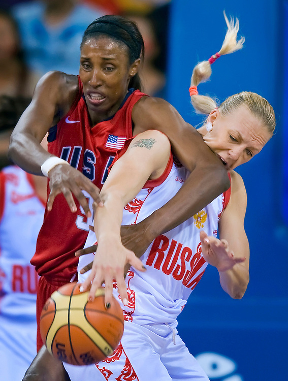 Lisa Leslie of the United States, left, battled Russia's Irina Osipova, right, with an elbow to the mouth for a rebound in the second half in the women's basketball semifinal contest on August 21, 2008 during the 2008 Summer Olympic Games in Beijing, China. (photo by David Eulitt / MCT)