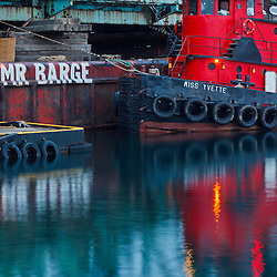 Tugboats alongside the barge, Cape Cod, which is carrying the middle span of the deconstructed Memorial Bridge in Portsmouth, New Hampshire.
