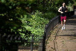 © Licensed to London News Pictures. 07/06/2021. London, UK. A man jogs during sunny weather in St James's Park in South Central London. Temperatures are expected to rise with highs of 24 degrees forecasted for parts of London and South East England today . Photo credit: George Cracknell Wright/LNP