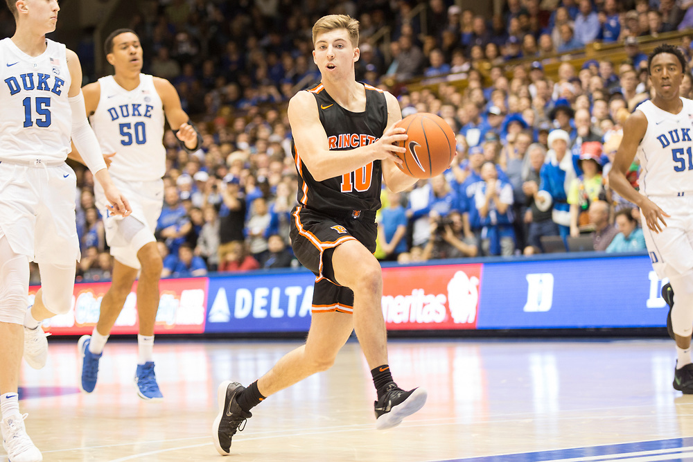 Princeton's Charlie Bagin moves past defenders during the Princeton Tigers away game against the Duke Blue Devils on December 18, 2018.