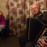 CAPTION: Alexander clearly knows how to delight his daughter. While he plays accordion and sings, his daughter Eva - who lives with Downs Syndrome - joins in on the electric organ, swaying rapidly from side to side and squealing with pleasure. Though her parents used to visit her regularly when she lived in a children's home during her first three years, she could never have experienced such bonding with them if she'd remained there. LOCATION: St Petersburg, Russia. INDIVIDUAL(S) PHOTOGRAPHED: Eva Nikolayeva (daughter) and Aleksander Nikolayev (father).