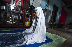 October 4, 2016 - Purworejo, CENTRAL JAVA, INDONESIA - Disabled Photographer Rusidah, photographs women with disabilities and operates her camera despite her own disability, in Purworejo, Central Java, Indonesia, Tuesday, October 4, 2016. This woman is adept at shooting even without fingers. She has her arm's to use as hands only, although she is without the presence of fingers and palms in her hands this has not hindered Rusidah from becoming a professional photographer. Born in 1968, Rusidah already started photographing in 1995. Armed with a camera received through government assistance in Purworejo, she originally took photos with film cameras. She is now shooting with a digital camera. (Credit Image: © Slamet Riyadi via ZUMA Wire)