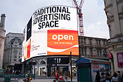 As Britain enters a period of deep recession, with retail and advertising struggling as the economic downturn caused by the Covid-19 pandemic cuts hard, the giant screens at Piccadilly Circus show slogans promoting their own advertising space on 13th August 2020 in London, United Kingdom. The Office for National Statistics / ONS has announced that gross domestic product / GDP, the widest gauge of economic health, fell by 20.4% in the second quarter of the year, compared with the previous quarter. This is the biggest decline since records began. The result is that Britain has officially entered recession, as the UK economy shrank more than any other major economy during the coronavirus outbreak.