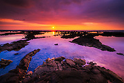 Sunset over the royal fishponds at Hapaiali'i Heiau, Kona Coast, The Big Island, Hawaii