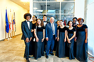 Garden City, New York, USA. June 6, 2019. At center, Apollo 17 astronaut HARRISON SCHMITT poses with Freeport High School Select Chorale members soon to perform at Apollo at 50 Anniversary Dinner at Cradle of Aviation Museum.