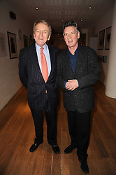 Left to right, SIR CHRISTOPHER MEYER and MICHAEL PALIN at the annual Orion Publishing Group's Author party held in the Paul Hamlyn Hall, The Royal Opera House, Covent Garden, London on 22nd February 2010.