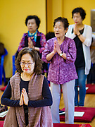 14 JUNE 2018 - SEOUL, SOUTH KOREA: Prayers at Chungjeongsa Temple, a Buddhist temple in Seoul. Koreans practice Tongbulgyo Buddhism, a derivative of Mahayana Buddhism, prevalent in China.       PHOTO BY JACK KURTZ