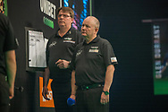 Scoring official Scott Gibling and referee George Noble during the Betway Premier League Darts Night Eight at Marshall Arena, Milton Keynes, United Kingdom on 21 April 2021