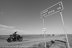 """Dan Emerson riding his 1936 Harley-Davidson Knucklehead into Limon, CO as he passes the """"MCR Half way to Tacoma"""" sign during Stage 9 (249 miles) of the Motorcycle Cannonball Cross-Country Endurance Run, which on this day ran from Burlington to Golden, CO., USA. Sunday, September 14, 2014.  Photography ©2014 Michael Lichter."""