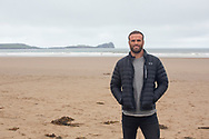 Rhossili Bay, Swansea, Wales, UK. Tuesday 21 August 2018. Former Wales rugby star Jamie Roberts at Rhossili, Gower, Swansea.<br /> <br /> Jamie Roberts is National Trust Wales's Outdoor and Well-Being ambassador and was at Rhossili to meet two National Trust Wales nature ambassadors who have walked the Wales Coastal Path.