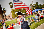 22 OCTOBER 2010 - PHOENIX, AZ:  JOHN ROSADO, from Glendale, AZ, dressed as a soldier in the Continental Army, talks to PATTY STETSON in Phoenix Friday. About 300 people attended a Tea Party rally on the lawn of the Arizona State Capitol in Phoenix Friday. They demanded lower taxes, less government spending, repeal of the health care reform bill, and strengthening of the US side of the US - Mexican border. They listened to Arizona politicians and applauded wildly when former Alaska Governor Sarah Palin and her son, Trig, made a surprise appearance. The event was a part of the Tea Party Express bus tour that is crossing the United States.     Photo by Jack Kurtz