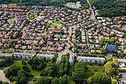 Nederland, Zuid-Holland, Den Haag, 15-07-2012; Sportlaan met flats uit de wederopbouw periode. Boven in beeld de Vogelwijk, rechts Allerheiligst Sacramentskerk..Aan weerszijden van de Sportlaan de 'Atlantikwall strook'. In dit gebied is tijdens de Tweede Wereldoorlog de bevolking geëvacueerd en de bebouwing ontruimd en/of gesloopt ivm aanleg tankgracht. .On both sides of the Sportlaan the Atlantic Wall strip. During the Second World War, the population of this area was evacuated and some of the buildings were demolished in order to build a antitank ditch. Post-war reconstruction appartment buildings...QQQ.luchtfoto (toeslag), aerial photo (additional fee required).foto/photo Siebe Swart