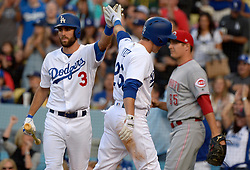 June 10, 2017 - Los Angeles, California, U.S. - Los Angeles Dodgers' Chase Utley (26) high fives teammate Chris Taylor (3) after scoring on a RBI double by teammate Corey Seager (not pictured) against the Cincinnati Reds in the first inning of a Major League baseball game at Dodger Stadium on Saturday, June 10, 2017 in Los Angeles. (Photo by Keith Birmingham, Pasadena Star-News/SCNG) (Credit Image: © San Gabriel Valley Tribune via ZUMA Wire)