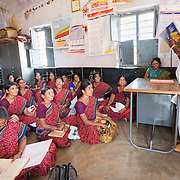 CAPTION: The Chamkol programme supports the government's response to the health and wellbeing of individuals with or at disk of disability. For Primary Health Centre (PHC) workers such as Shilpa - seen here addressing a meeting of anganwadi workers - this means informal support during disability screenings, vaccination and immunisation outreaches. LOCATION: Benderwadi (village), Kasaba (hobli), Chamrajnagar (district), Karnataka (state), India. INDIVIDUAL(S) PHOTOGRAPHED: Shilpa K.N.