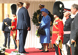 US President Donald Trump and first lady Melania Trump are greeted by Queen Elizabeth II as they arrive at Windsor Castle, Windsor.