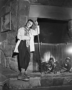 Y-501108-12.  Don Austin, the fireplace poker man, Timberline Lodge. November 8, 1950