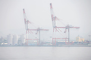 big container cranes on an overcast day