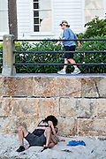 A young amorous couple makes out along the High Battery as tourists stop to view the harbor in Charleston, SC.