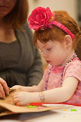 United States, Washington, Bellevue, girl (age 2) doing crafts at KidsQuest Children's Museum.  MR, PR