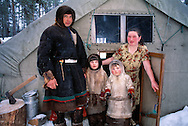 Komi reindeer herdsman and his family, in front of the family tent, Kánin Peninsula, Russia, Arctic