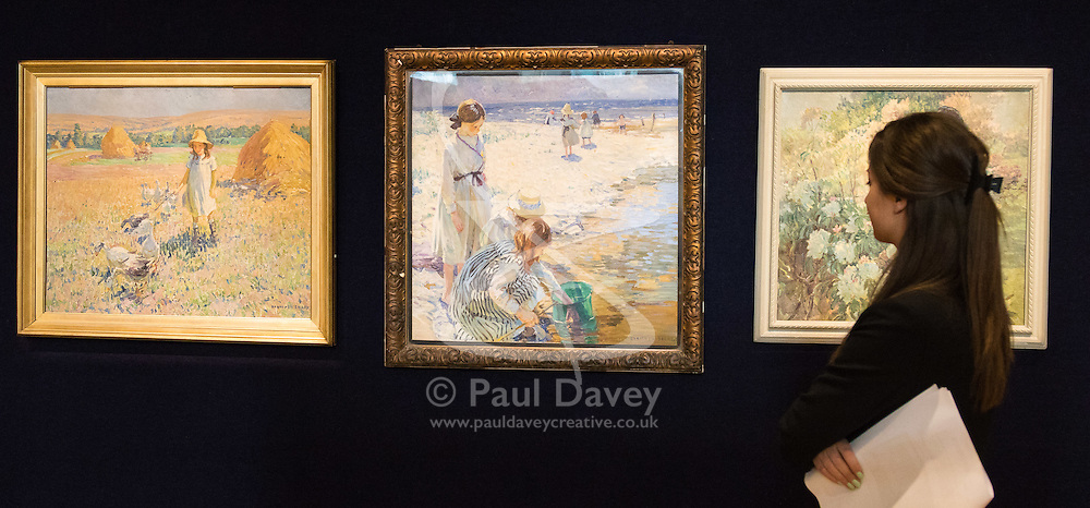 "Bonhams, Mayfair, London, February 26th 2016. A woman admires Dorothea Sharp's  ""In The Shallows"", that sits between two of her other paintings and is expected to fetch between £40-60,000 at the Bonhams 19th Century Art Sale in Mayfair, London on March 2nd 2016. ///FOR LICENCING CONTACT: paul@pauldaveycreative.co.uk TEL:+44 (0) 7966 016 296 or +44 (0) 20 8969 6875. ©2015 Paul R Davey. All rights reserved."