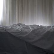 An unmade bed in Noosa Heads, Australia.